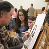 Sisters Victoria and Elizabeth Teixiera sat for artist Mike Valentine, who did caricatures on Saturday. Like all other participants, Mr Valentine donated his time and talent for the winter carnival. (Hicks photo)
