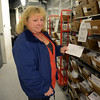 Holding up one piece of a massive amount of mail flooding the town since December 14 was post office employee Lynn Knapp, who was among a group of postal volunteers helping to sort as much as 45,000 letters, envelopes, and packages Sunday, January 6. (Bobowick photo)