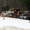 At the request of Police Chief Michael Kehoe, Public Works crews placed large cement blocks in the driveway of Sandy Hook Elementary School on Friday, January 4. The blocks narrowed the driveway down to one passable lane, which in turn increases security of the crime scene where 26 adults and children were murdered on December 14. (Hicks photo)