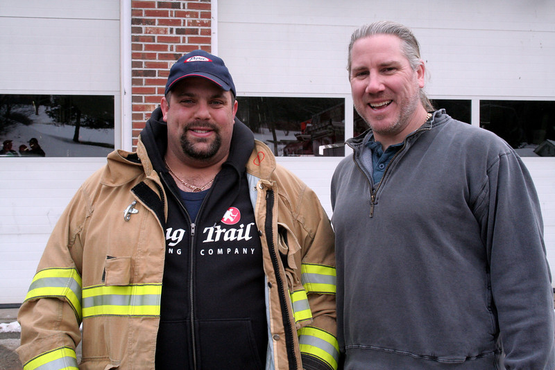 Anthony Capozziello, left, and Greg Gnandt stand together on January 1 as twenty-six copper stars were attached to the roof of the Sandy Hook Fire & Rescue main station. (HIcks photo)