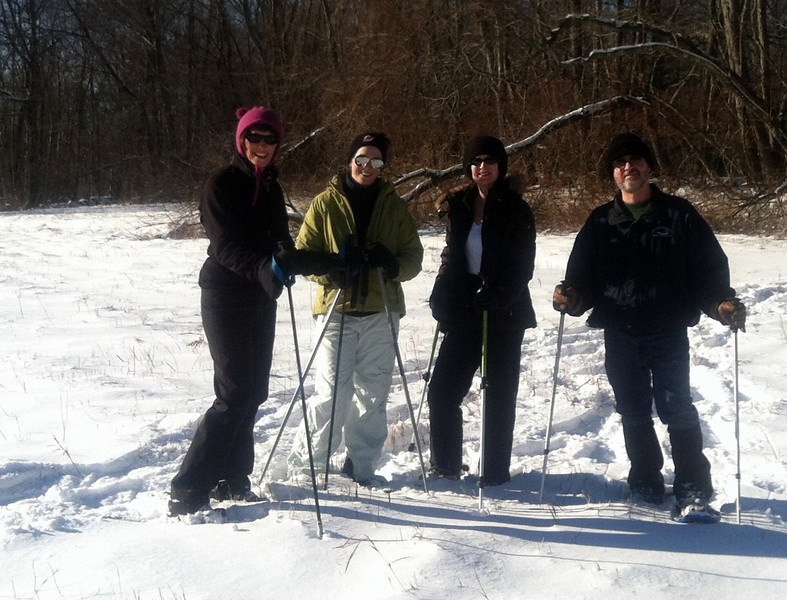 Snowshoeing is the fastest growing winter sport in the world, requiring little athletic ability and little equipment. Four snowshoers take advantage of the recent snowfall in Newtown.  (Crevier photo)
