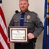 Newtown Police Patrol Officer Jeffrey Silver displays an award that he recently received from the American Automobile Association (AAA) of Southern New England for his work in the area of traffic safety. Through the award, known as the Traffic Safety Hero of the Year, the AAA recognizes Ofc Silver for his continuing efforts to protect citizens and educate them about traffic safety. Ofc Silver, who is the police department's commercial truck inspector, is a member of the department's traffic enforcement unit. (Gorosko photo)