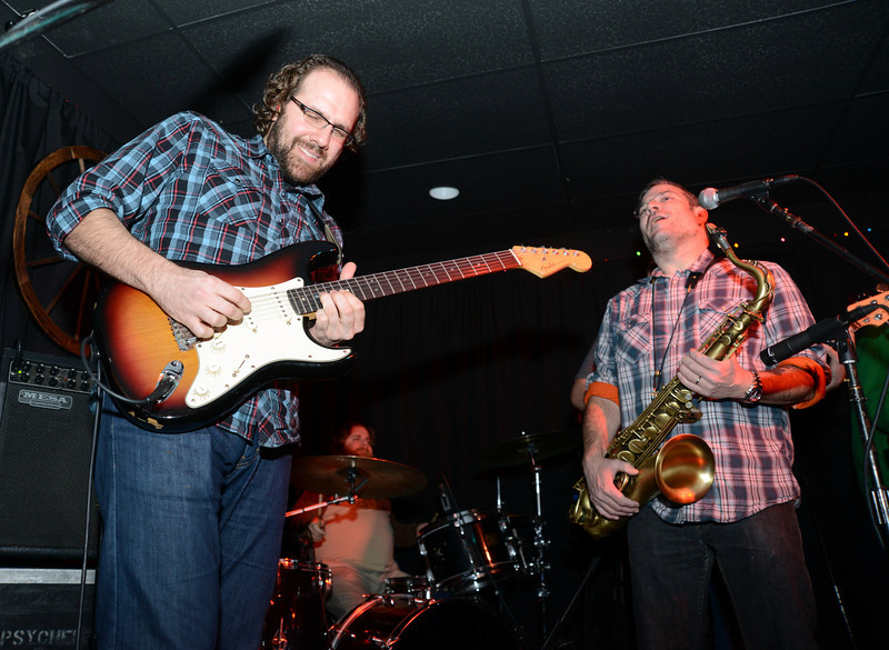 "On the guitar was Tim Palmieri with Rob Somerville on the sax. Behind them is drummer Adrian Tramontano when the band Kung Fu out of New Haven played for a full house at The One Eyed Pig during a ""healing through music"" concert Saturday, January 5. (Bobowick photo)"