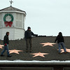 Twenty-six copper stars were attached to the roof of the Sandy Hook Fire & Rescue main station on New Year's Day, representing the lives that were taken 18 days earlier at Sandy Hook Elementary School. Trumbull resident Greg Gnandt, who has close ties to Newtown, spearheaded the project. It is one of the first permanent memorials to the victims of December 14. (Hicks photo)