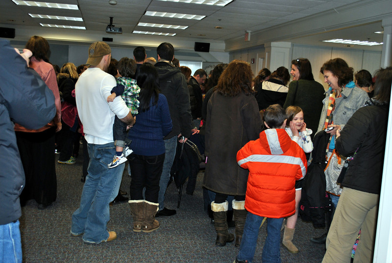 The Meeting Room in the C.H. Booth Library was wall to wall with families eager to greet Magic, one of three Gentle Carousel Miniature Therapy Horses, that visited Saturday, January 5, from 11 am to 2 pm. (Crevier photo)