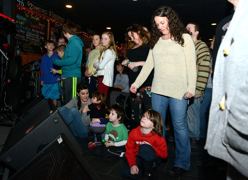 "Children crouched up front where the band Kung Fu out of New Haven played for a full house at The One Eyed Pig during a ""healing through music"" concert Saturday, January 5. (Bobowick photo)"