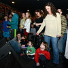 """Children crouched up front where the band Kung Fu out of New Haven played for a full house at The One Eyed Pig during a """"healing through music"""" concert Saturday, January 5. (Bobowick photo)"""