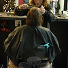 Bonnie Fredericks, the proprietor of Sandy Hook Hair Company at 102 Church Hill Road in Sandy Hook Center, cuts the hair of a client at the salon on Sunday, January 13. (Gorosko photo)