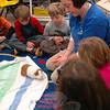 Connecticut Audubon Society teacher and naturalist Tricia Kevalis introduced Henry, a guinea pig, to students in Miryam Kuligowski's kindergarten class on Thursday, January 10. (Hallabeck photo)