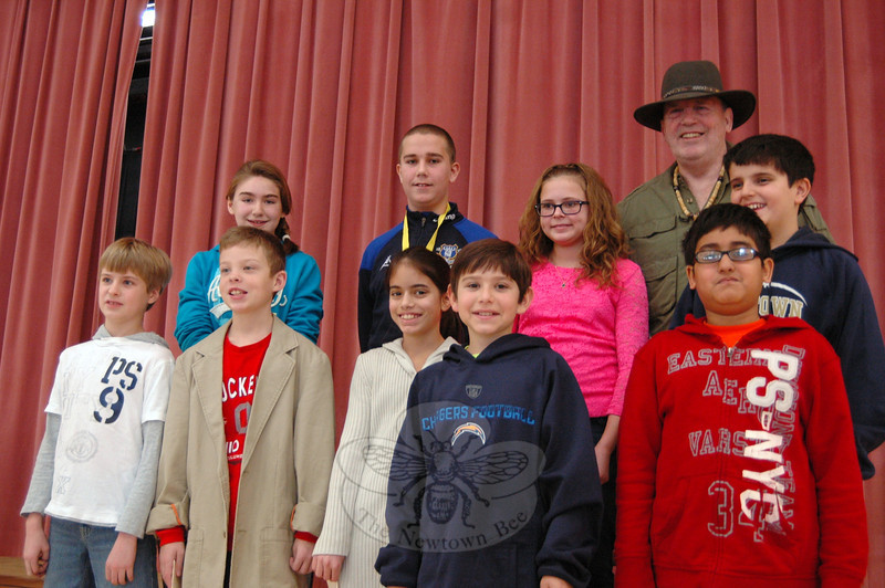 "Contenders in this year's National Geographic Geography Bee at Reed Intermediate School stand together after the competition held on Monday, January 14. Reed Principal Jay Smith, back row right, came dressed in his alter-ego ""Nebraska Smith,"" Indiana Jones's fifth cousin. (Hallabeck photo)"