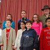 """Contenders in this year's National Geographic Geography Bee at Reed Intermediate School stand together after the competition held on Monday, January 14. Reed Principal Jay Smith, back row right, came dressed in his alter-ego """"Nebraska Smith,"""" Indiana Jones's fifth cousin. (Hallabeck photo)"""