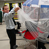 Joseph Doherty demonstrates his Sun Seat, designed to protects user from the sun and bugs, at the Thursday, January 10, St Rose of Lima School Invention Convention. (Hallabeck photo)