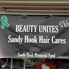 A banner hung outside the Sandy Hook Hair Company in Sandy Hook Center advertised the fundraising event within Sandy Hook Hair Company. (Gorosko photo)