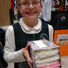 Stella Sabo shows her Top Notch Tissues, a tissue box that indicates when it is running low, at the Thursday, January 10, St Rose of Lima School Invention Convention. (Hallabeck photo)