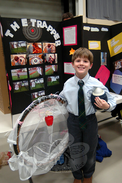 Liam Wolson stood with his design for The Trapper, a football-catching device, on Thursday, January 10, during St Rose of Lima School's Invention Convention. (Hallabeck photo)