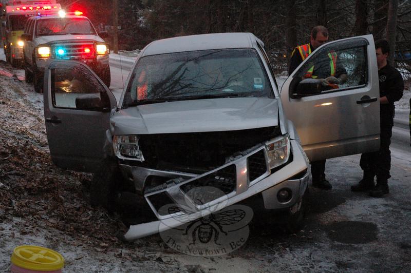 Police report a one-vehicle accident during slippery conditions late on the afternoon of Monday, January 21, on Toddy Hill Road, just north of its intersection with Settlers Lane.  Police said motorist Domingos Justo, 48, of Shelton was driving a 2005 Nissan Frontier pickup truck southward on a snow-covered Toddy Hill Road at about 4:17 pm, when the vehicle slid on the snow-covered road and went out of control. The truck crossed over into the northbound lane and then struck a  large tree along the northbound road shoulder, police said. Ambulance staffers transported Justo to Danbury Hospital to be checked for injuries, police said. Botsford volunteer firefighters responded to the incident. The accident caused travel delays in the area. Police said they issued Justo an infraction for traveling too fast for conditions. (Gorosko photo)