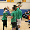 Assistant Superintendent of Schools Linda Gejda, left, high-fived her way past members of the Newtown Strong basketball team, assembled on Saturday, January 19, to take on the visiting Harlem Wizards. (Hallabeck photo)