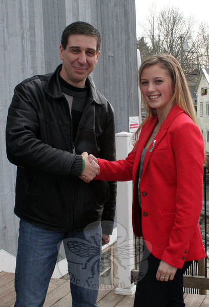 Isabel Linzer, right, collected $2,500 in her Virginia community to donate to the Newtown Memorial Fund. On Saturday, January 19, Isabel hand delivered her donation to Newtown Memorial Fund Founder Brian Mauriello, left. (Hallabeck photo)