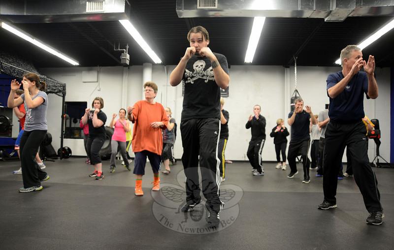 Gordon Johnson, center, works through a defense routine while warming up for a Krav Maga class Wednesday. (Bobowick photo)