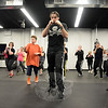 Gordon Johnson, center, works through a defense routine while warming up for a Krav Maga class Wednesday. (Bobowick photo)