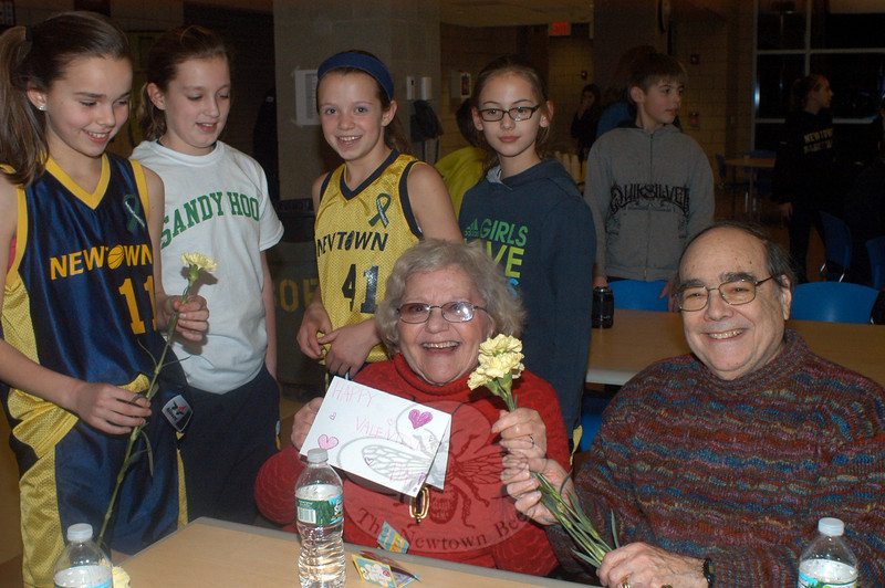 Betsy and Kenny Jacobson with youth basketball players, from left: Sarah Tressler, Ashley Hammond, Katie Ryan, and Juliette Cryder. (Hutchison photo)
