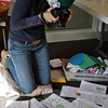Yolie Moreno photographs letters of condolence received from a kindergarten class, at the Newtown Municipal Center. Ms Moreno and volunteers are dedicating hours of time to document the thousands of letters, banners, and cards that the town has received, and plans to post them all to a website when the project is finished. (Crevier photo)