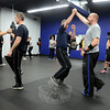 Krav Maga class instructor Chris Petitti, right, talks about balance as he demonstrates with Chris Anderheggen. (Bobowick photo)