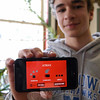 Newtown High School freshmen Brendan Gregory shows off his recent iPhone/iPad app, Atrixx.  (Hallabeck photo)