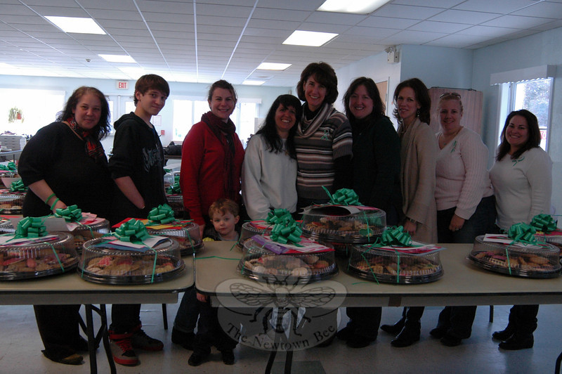 Volunteers for the Sandy Hook School Valentines For Heroes effort sorted cookies on Tuesday, February 12, at the Newtown United Methodist Church. Project co-chairs Barb Sibley, fifth from right, and Karyn Holden, fourth from right, stand with the group. (Hallabeck photo)