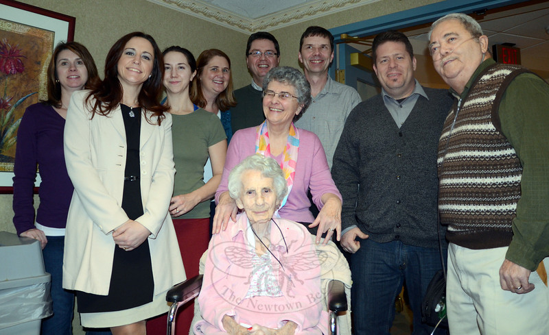Newtowner and former Newtown Bee social correspondent Sylvia Davidson, seated, is surrounded by her children and grandchildren during a 100th birthday celebration February 2 at Masonicare. Among her immediate family members attending were, from left, Stacy Orr, Kimberly Gyenizs, Brianne Davidson, Karen Sword-Davidson, Peter Sword, Carl Sword, Elizabeth Sword, Charles Davidson, and Howard Davidson. (Voket photo)