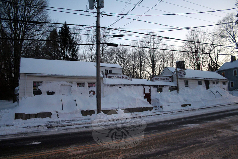 Snow drifts created a challenge for many when it came time to dig out following last weekend's blizzard. Sandy Hook Diner proprietors Ellie Lewis and Cliff Rothe had snow covering the sidewalk, stairs, and even most of the diner's front windows by the end of the storm Saturday. (Hicks photo)