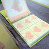 Easton, Mass., resident Kathy Endriunas had collected messages of support and hope in a photo album for Newtown. On each white card was a hand painted pastel pink heart. After taking the blank cards around Easton, Mass., to be filled, individual messages of hope and support for Newtown were sent to Newtown. (Bobowick photo)