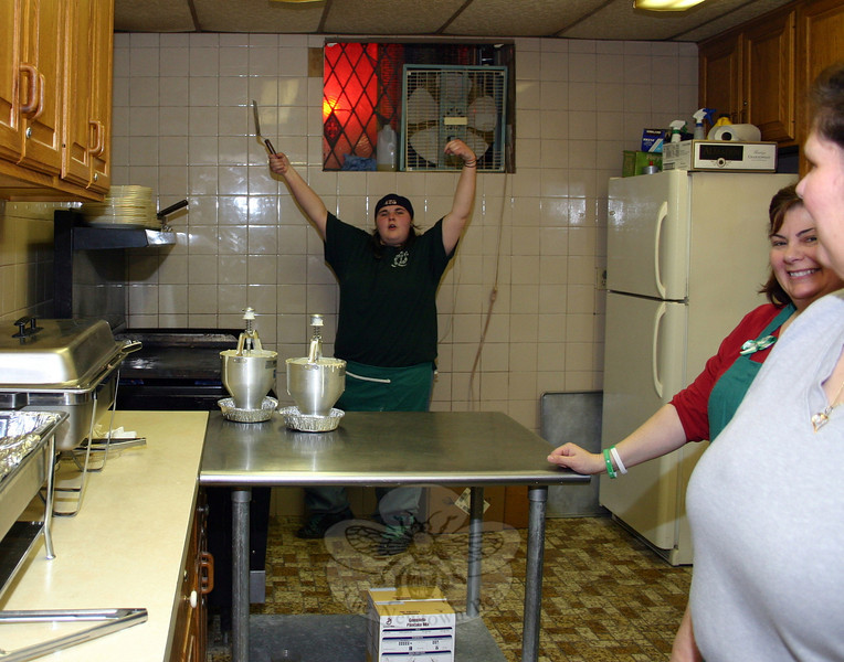 "Erica Knapp flips one of the thousands of pancakes she helped cook up last week during the 56th Shrove Tuesday Pancake Supper at St John's Church. The annual event, held this year on February 12, had a great turnout ""from all around town, and from surrounding towns as well,"" according to Cheryl Moulthrop, a longtime member of St John's and the wife of church Warden Bruce Moulthrop. ""Many familiar faces … as well as some new faces"" attended the dinner, said Mrs Moulthrop. In addition to dozens of guests who showed up for dinner, the church was blessed with help prior to the event from Scott Kimball of W. Kimball, Inc, who cleared the parking lot of snow the night before the dinner; Bob McCulloch of Newtown Tree Service, for his ongoing efforts to keep the lot plowed and sanded; as well as donations of food and paper products from Blue Colony Diner, Ace Endico of Brewster, and The Warehouse Store. (Hicks photo)"
