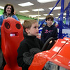 Dan Godino steers his way through a game of Cars. Children and adults maneuvered controls translating moves to onscreen race cars and motorcycles Saturday, February 16, during the grand opening of Newtown's new Sandy Hook Arcade Center (SHAC), which has sprung up in record time in Sand Hill Plaza, 228 South Main Street.  (Bobowick photo)