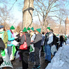 Supporters line up on Trinity Street in Hartford, beside the buses that carried them from towns across the state, Thursday, February 14, to the March for Change rally at the State Capitol. The Sandy Hook Elementary School colors of green and white dominated the crowd of 5,500 that arrived to hear speakers promoting the need for changes to gun laws. (Crevier photo)