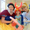 Sisters Caroline and Katherine Brickley of New Canaan dressed as Snow White, left, and Cinderella as they sat with young resident Annika Fogal during the Miles of Smiles children's festival brought to town by Ron VillaReale of Easton, Mass., and a host of volunteers from neighboring states. (Bobowick photo)