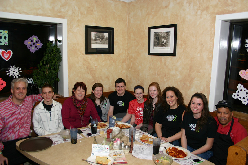 Newtown High School faculty spent three hours serving dinners at The Pizza Palace on February 12, raising funds for NHS Peer Leadership to donate to The Sandy Hook School Support Fund. From left is NHS teacher Larry Saladin, Peer Leadership President Nick Sajovic, Janet Flanagan, Aoife Flanagan, Matt Rahtelli, Grainne Flanagan, Sinead Flanagan, Peer Leadership Co-Advisor Vivian Sheen, Ryanne Duffy, and Chico, who has been a busboy at the restaurant for decades. (Hicks photo)