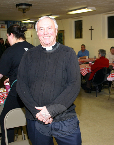"Hundreds of people visited St John's Episcopal Church for its Shrove Tuesday Pancake Supper last week. The Reverend Mark Moore tried to greet each of them as they walked into the church's undercroft. The dinner raised funds this year for the church, as well as Sandy Hook Promise. Each group received $667, according to Cheryl Moulthrop. In addition, ""thanks to other contributions coming into St John's from around the country, we were also able to donate to [Sandy Hook Fire & Rescue] for $226.78 as well as Newtown Police Union for same amount, and to Sandy Hook School Support Fund for $560,"" Mrs Moulthrop said. (Hicks photo)"