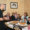 NHS Guidance Counselor and Peer Leadership Co-Advisor Brett Nichols takes an order, and gets a few laughs, from his family, at The Pizza Palace on February 12, raising funds for NHS Peer Leadership to donate to The Sandy Hook School Support Fund. From left is his father-in-law, Don Richards; wife, Megin; children Sadie and Lincoln; mother-in-law Tina Richards; and children Max and Juliette. (Hicks photo)
