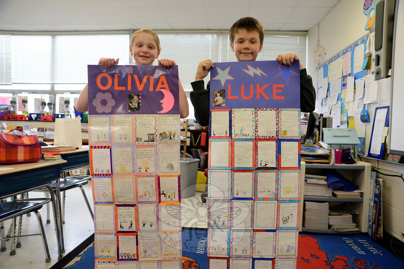 Olivia Buchler and Luke O'Connor show off their finished quilts compiled from classmates' positive comments at Middle Gate Elementary School, on Wednesday, February 20. (Bobowick photo)