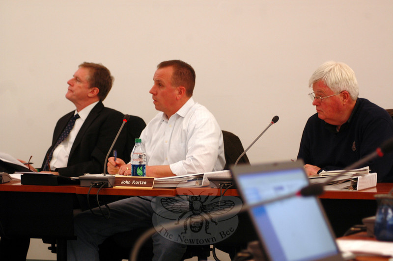 From left, Board of Finance member Joseph Kearney, Chair John Kortze, and member Harry Waterbury listen as the Board of Education's proposed 2013-14 budget is presented on Tuesday, February, 26. (Hallabeck photo)
