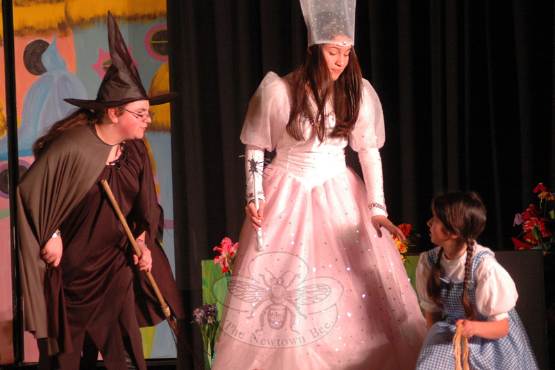 From left, Melissa Shohet, Kyra Alvarez, and Talia Hankin perform on Tuesday, March 12, during a dress rehearsal for the Newtown Middle School upcoming production of The Wizard of Oz. (Hallabeck photo)