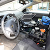 The Ford Crown Victoria interior — a police officer's rolling office — is more confined in the department's new Chevrolet cruisers, and requires each new vehicle to be newly outfitted with all the brackets, harnesses and gear required to accommodate the hardware officers require. Very few components in the retiring Ford sedans can be transferred into the new patrol vehicles. (Voket photo)
