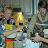 Book club members from left, Nancy Carlin, Ros Liljengren, Sue Tarshis, and Mary Tomasiewicz, and First Selectman Pat Llodra, center, dig into a bag of flour. (Crevier photo)