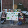 Newtown Girl Scouts have launched the 2013 cookie sale season, and this group — representing Newtown Brownie Troop 50999, from Hawley School — spent part of Saturday, March 9, outside Dunkin' Donuts. From left are Lexi Ferrara, Lizzy Gotschlich, and Alyssa Bova. Cookies are $4 a box, and there are plenty available. Sales will continue for at least three more weeks at locations to include Blue Colony Diner, Newtown Hardware, Stop & Shop and Walgreens. (Hicks photo)