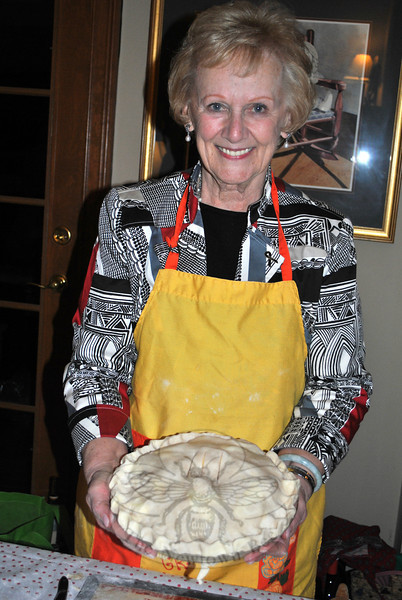 Mrs Llodra proudly displays the result of her newest endeavor: pie making. (Crevier photo)