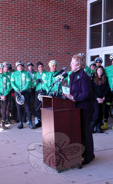 First Selectman Pat Llodra speaks at a rally held at Reed Intermediate School on Saturday, March 9, to send off Team 26 on a 400 mile cycling journey to Washington, D.C. (Hallabeck photo)