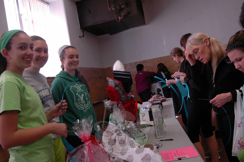 "From left, Faith Rapley, Kimberly Sands, and Nicole Demelo sold raffle tickets at a VGroove Fitness ""Shake It For Sandy Hook"" Cardio dance fundraiser on Saturday, March 9, in the gymnasium at Edmond Town Hall. (Hallabeck photo)"