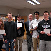 Newtown High School students who have been named as finalists in the 2013 Competition for National Merit Scholarships were recognized on Tuesday, March 12, when NHS Principal Charles Dumais, center, awarded them certificates. Photographed, not in order, are Jay DeStories, Caitlin Gibney, Joseph Kohrman-Glaser, Karan Marwah, Anthony Pagett, and Alexander Strzelecki. Lauren Frazzetta was not present for the photo, but was also named as a finalist. The NHS seniors were among roughly the top 16,000 students in the nation to earn the semifinalist recognition in September. As finalists in the scholarship program the six NHS students are now among the top 2,500 students in the country. National Merit Scholars are eligible for consideration for awards. (Hallabeck photo)