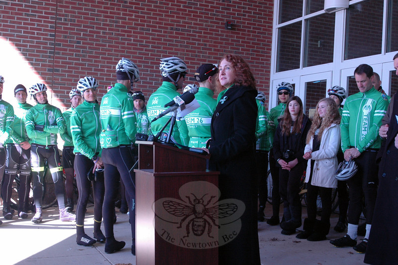 "Congresswoman Elizabeth Esty asked members of Team 26 to demonstrate the back of their jackets, which read, ""We ride for peace, hope and love,""  at a rally held at Reed Intermediate School on Saturday, March 9, to send off Team 26 on a 400 mile cycling journey to Washington, D.C. (Hallabeck photo)"